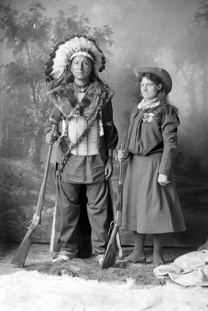 Annie_Oakley_with_Indian_by_DF_Barry.jpg